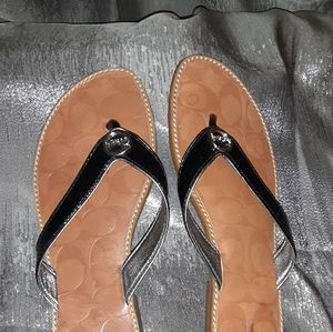 "Coach black and tan ""Deney"" flip flops"